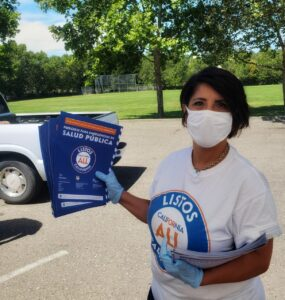 The founder of Nuestra Comunidad holding flyers