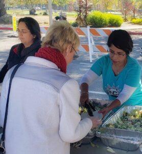 Volunteers handing out food