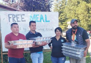 A team of volunteers handing out free meals
